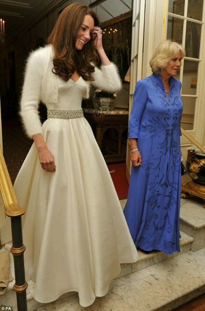 Kate Middleton changes into wedding reception dress, also by Sarah Burton, with blinged out bridal b