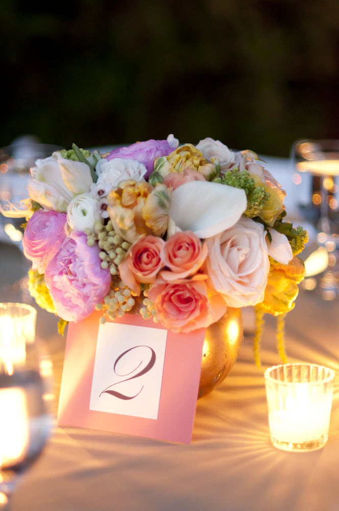 Romantic outdoor wedding reception tablescape with pastel wedding flower