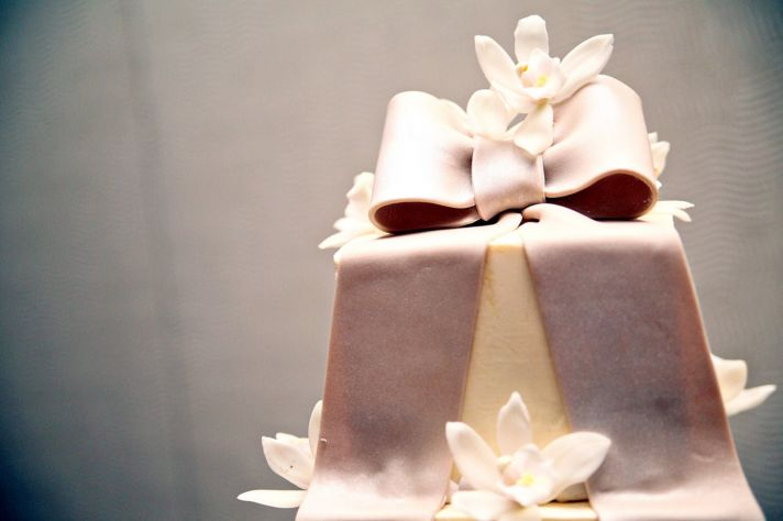Ivory fondant square wedding cake with orchid sugar flowers