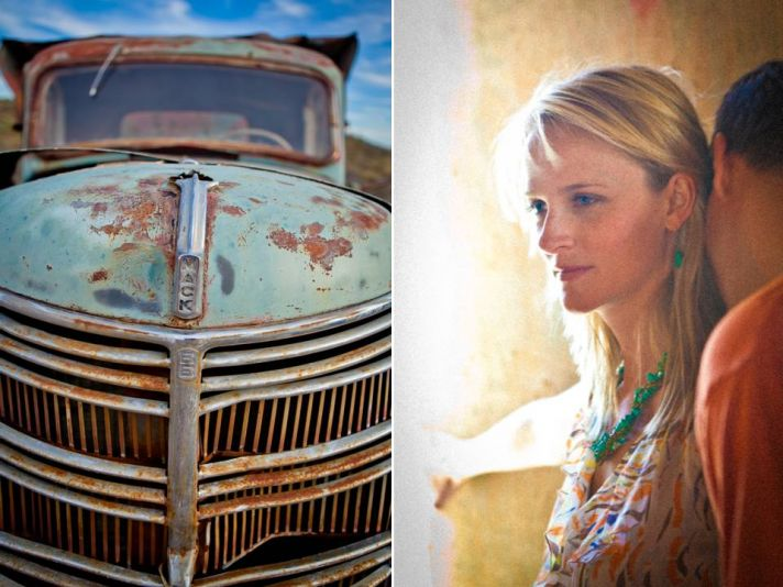 Beautiful bride and groom pose near vintage pickup truck during Arizona engagement session