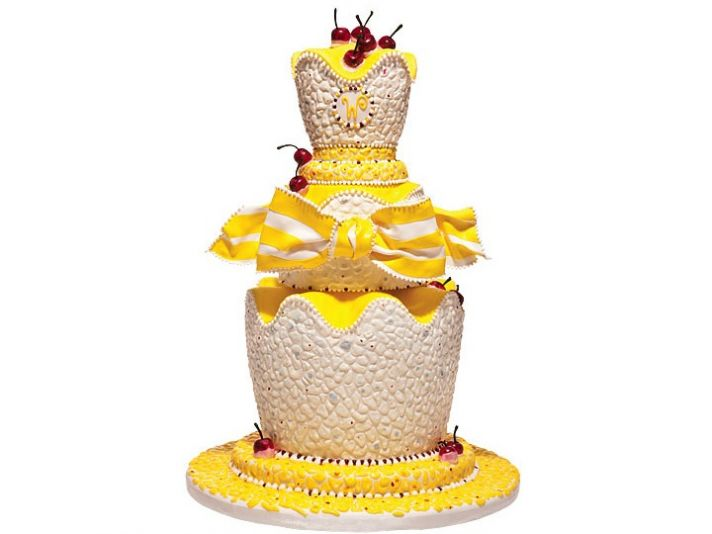 Make a statement with this ivory, yellow and red cherry-adorned summer wedding cake