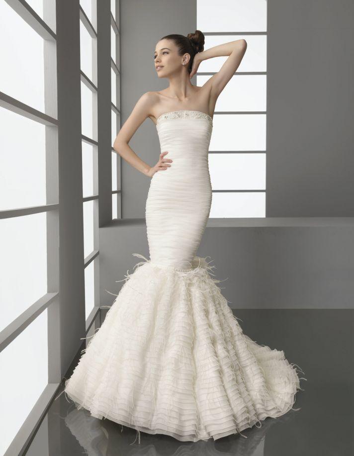 Strapless drop waist mermaid wedding dress with feather-adorned trumpet skirt