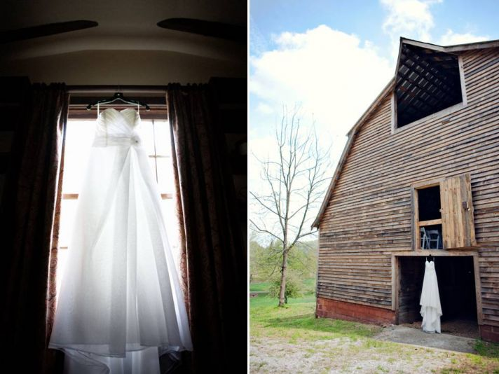 Simple white sweetheart wedding dress hangs in window of rustic wedding venue