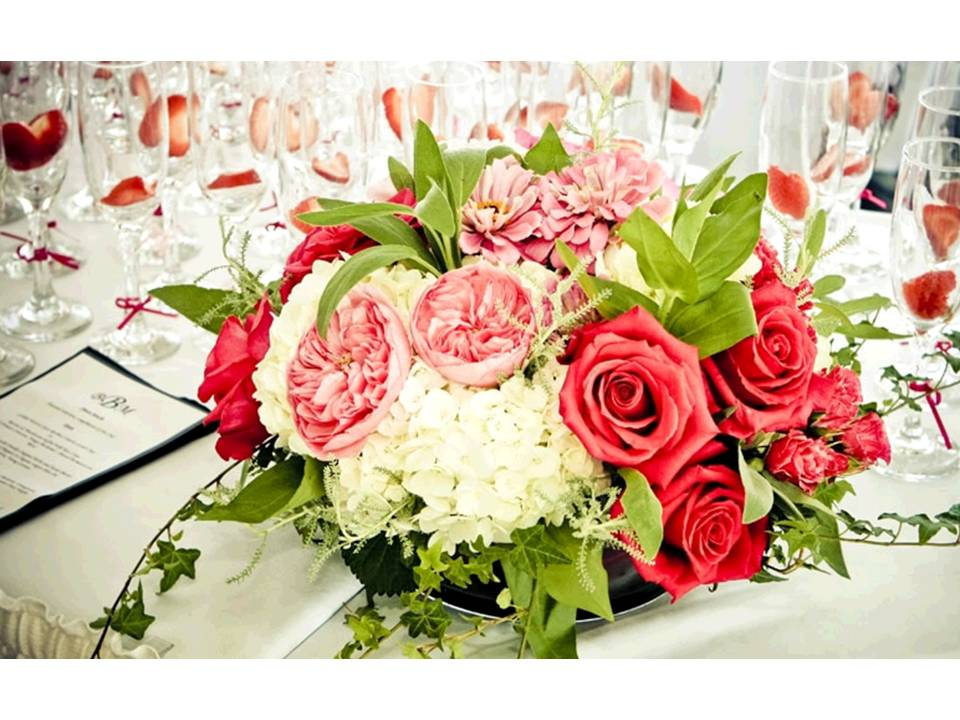 Romantic coral pink ivory and sage wedding flower centerpieces