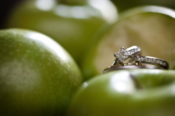 Green apple themed wedding- engagement ring wedding photo