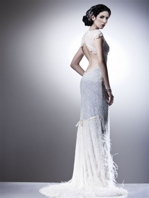 Stunning lace and beaded vintage wedding dress with open back