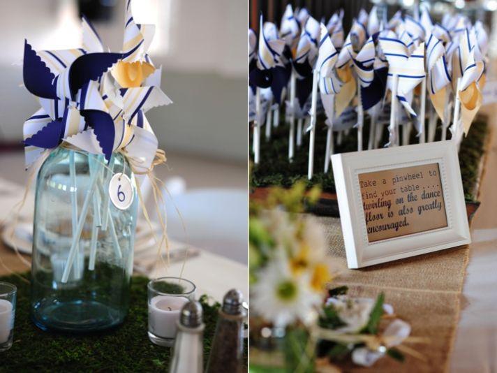 Adorable wedding reception escort card idea- personalized pinwheels