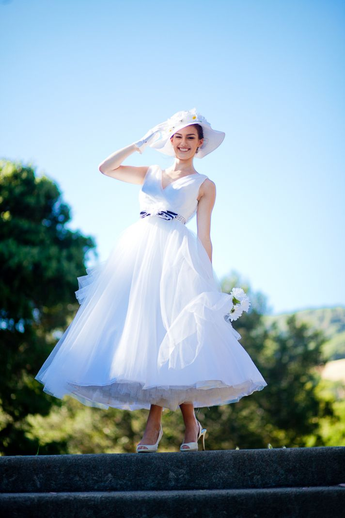tea-length tulle wedding dress, chic belt and summer wedding hat