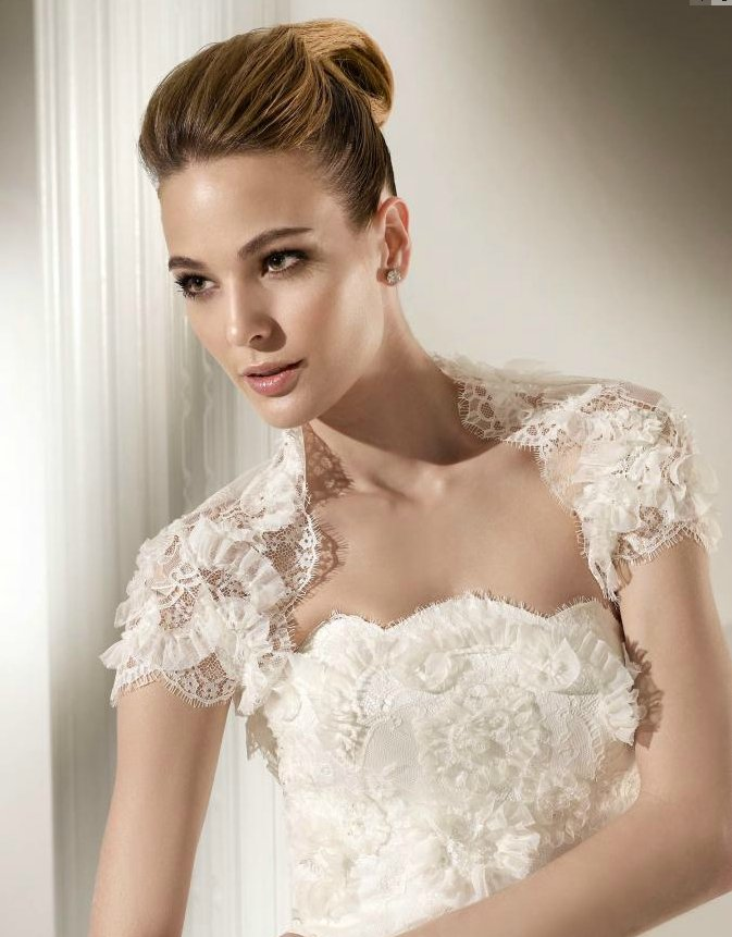 Float down the white aisle with this wedding dress for Wedding dress lace bolero