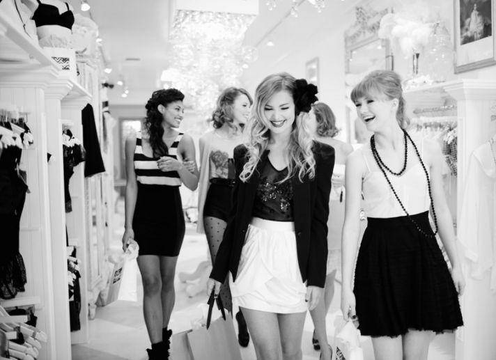 Vintage chic bride and bridesmaids have a ball at lingerie boutique bachelorette party