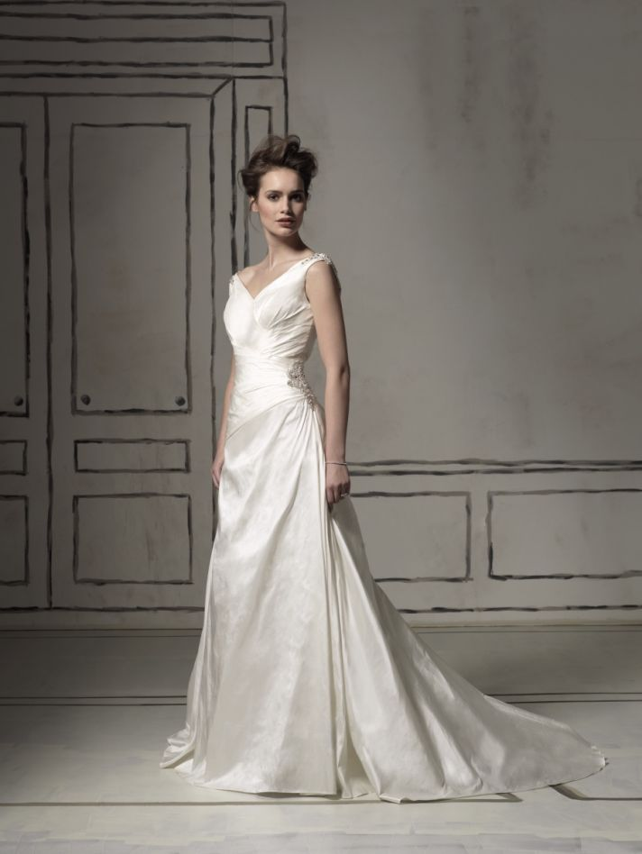 Traditional ivory modified a-line v-neck wedding dress