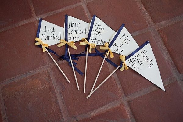 DIY wedding pennants in navy blue and yellow wedding color palette