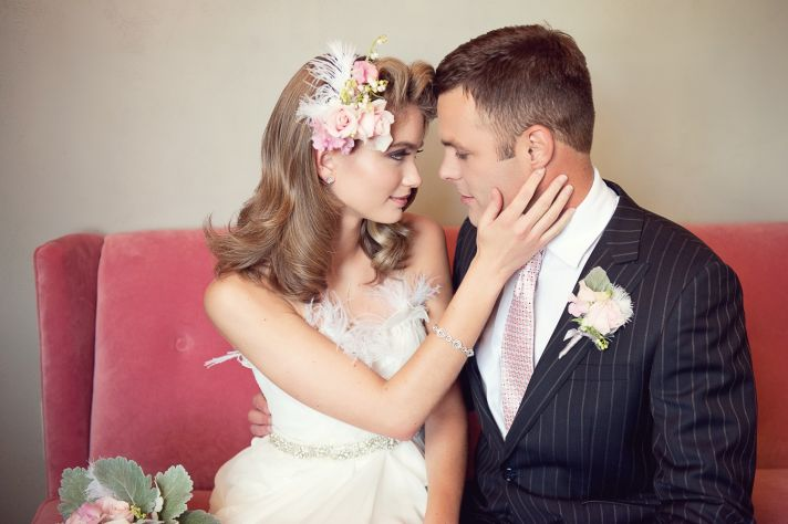 Bride wears vintage-inspired wedding hairstyle, glam wedding dress