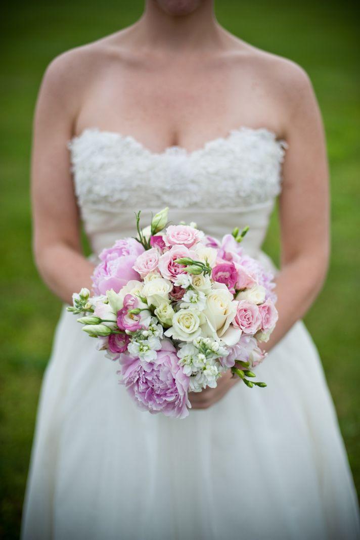 Virginia bride wears strapless wedding dress, holds romantic bridal bouquet