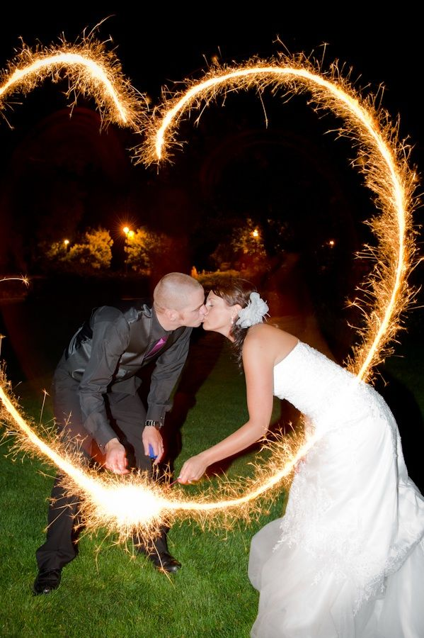Bride and groom kiss under sparklers heart Credit Outdoor Colorado wedding
