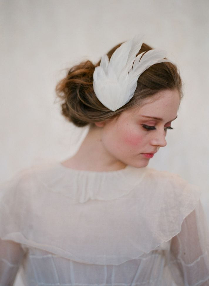 Feather-adorned bridal headband