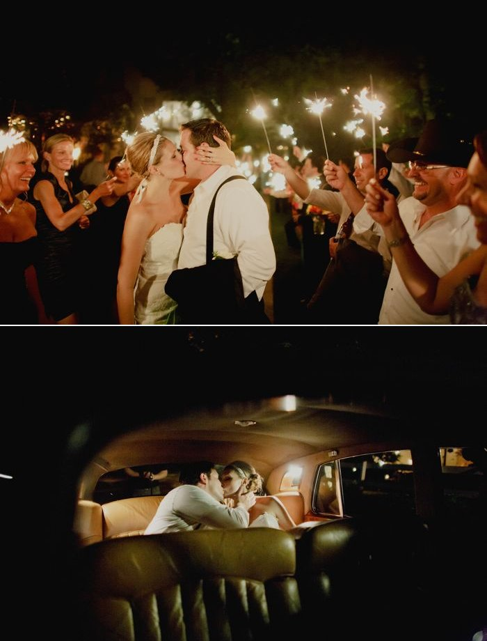 Wedding guests see off bride and groom with sparklers