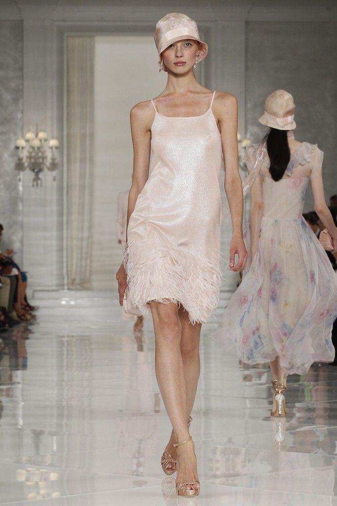 Champagne metallic Ralph Lauren wedding reception dress with feathers on hem