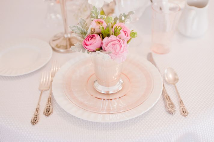 Pink and white wedding flowers arranged in stunning DIY centerpieces