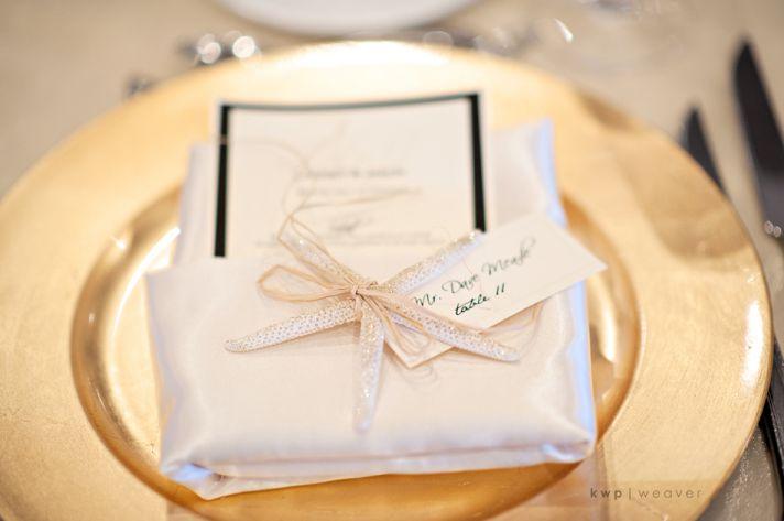 Elegant gold beach themed wedding reception decor