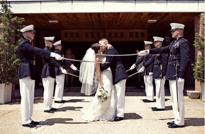 Bride-groom-kisss-military-groomsmen