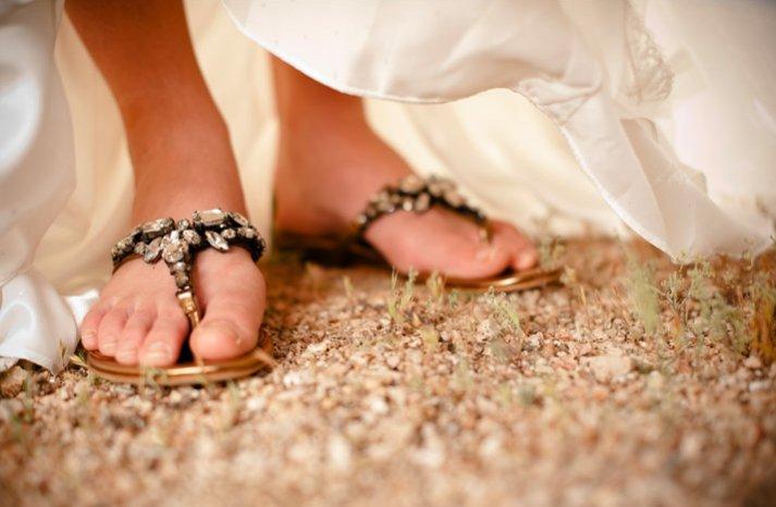 desert chic wedding bride wears bejeweled sandals