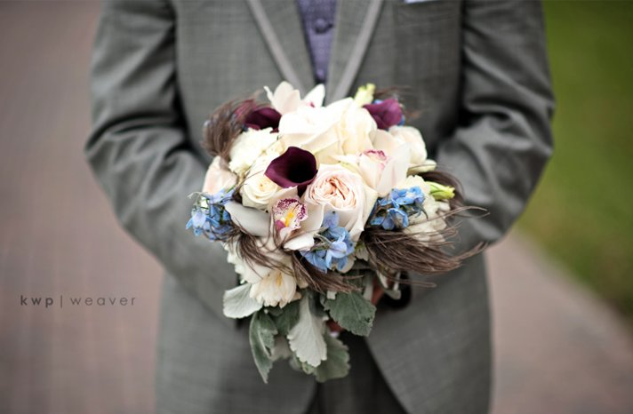 wedding photography must have photos groom holds brides bouquet