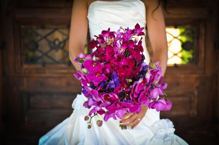 bright wedding flowers bridal bouquet orchids fuschia purple