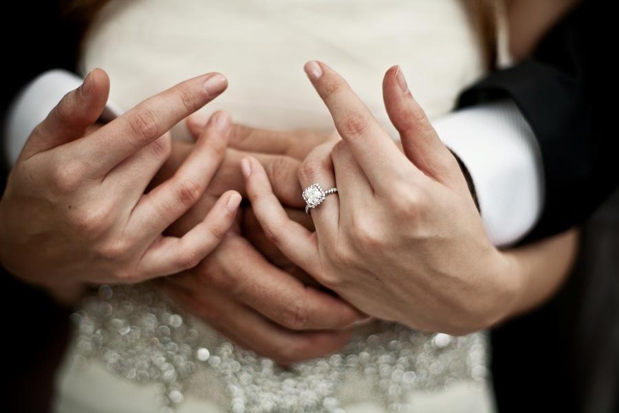 artistic wedding photography diamond engagement ring shot