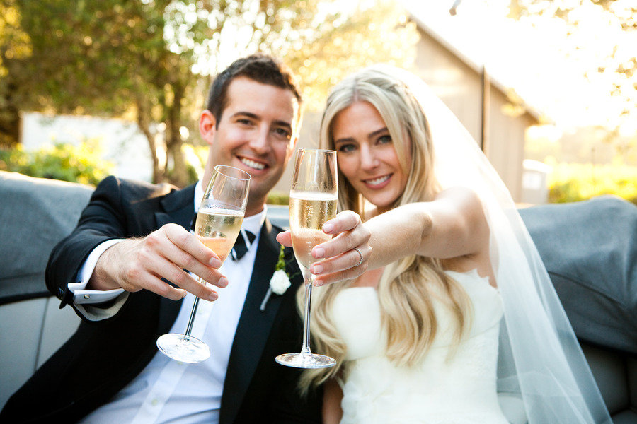 bride groom toast with champagne black tie outdoor reception