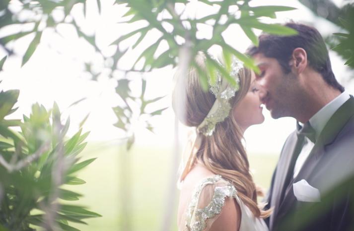beach wedding bright wedding color palette pink bride groom kiss