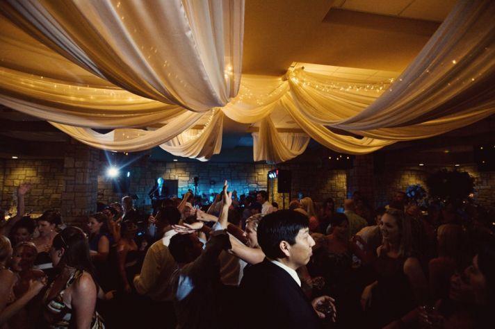 elegant draping on wedding reception venue ceiling