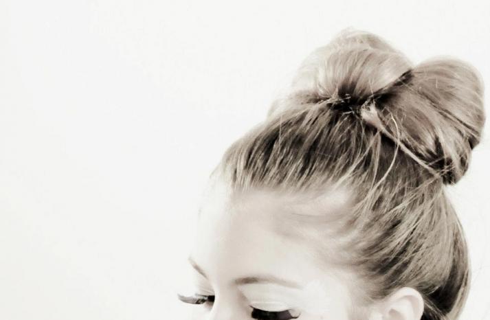 bow bun black white wedding photo