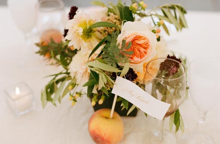 elegant real wedding outdoor reception under tent peach escort card holders