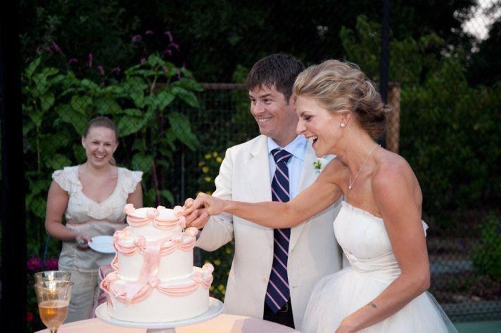 bow adorned wedding cake bride and groom