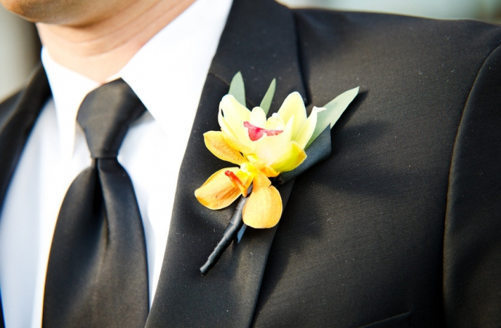 yellow orchid grooms boutonniere real wedding photo