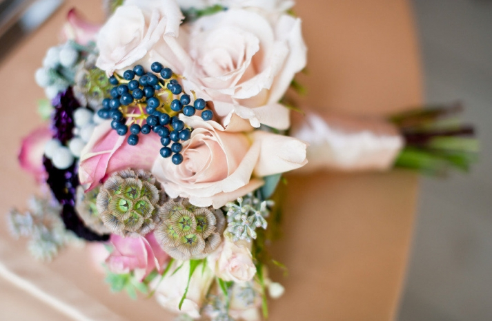 romantic bridal bouquet roses berries