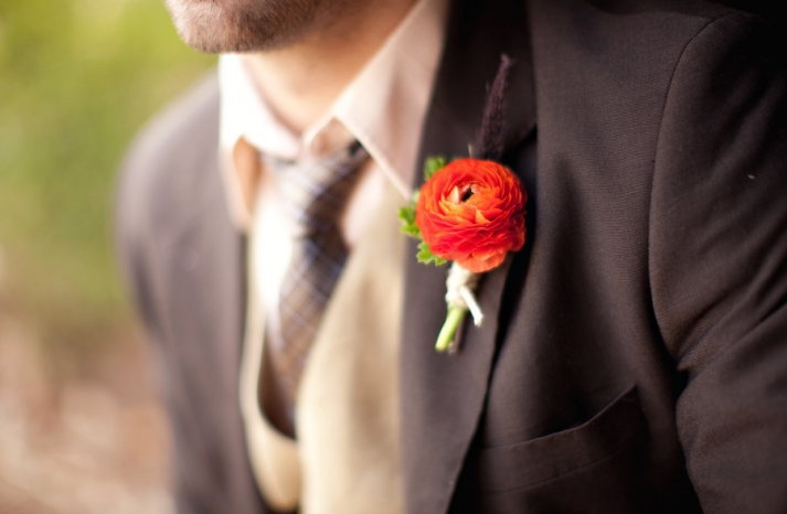 grooms boutonniere orange anemone dark brown suit