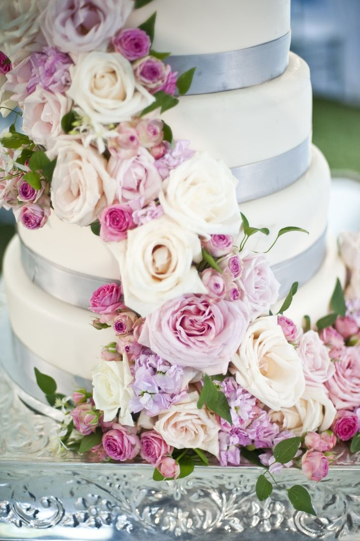 romantic wedding cake with cascading roses