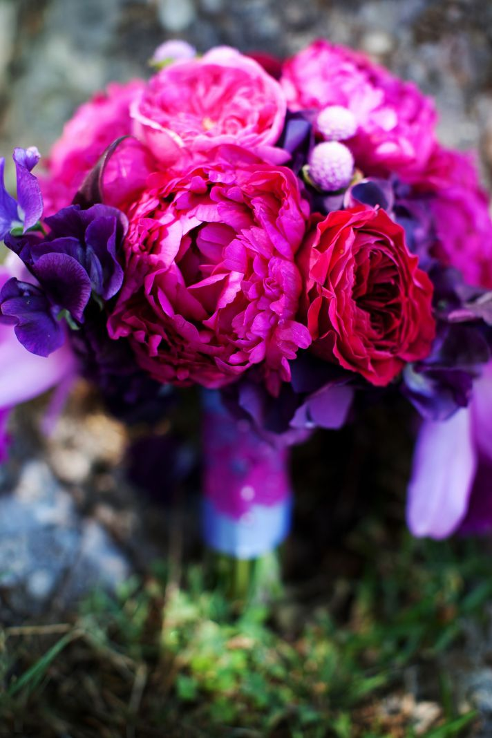 elegant malibu wedding with bold wedding flowers purple pink bouquet