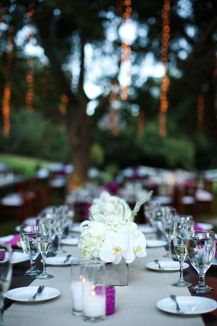outdoor wedding reception long banquet tables ivory wedding flowers