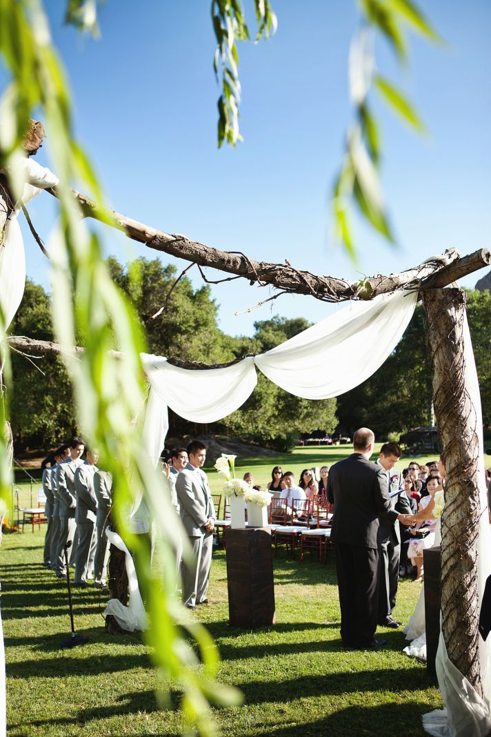 elegant California wedding with bold florals personalized details arbor