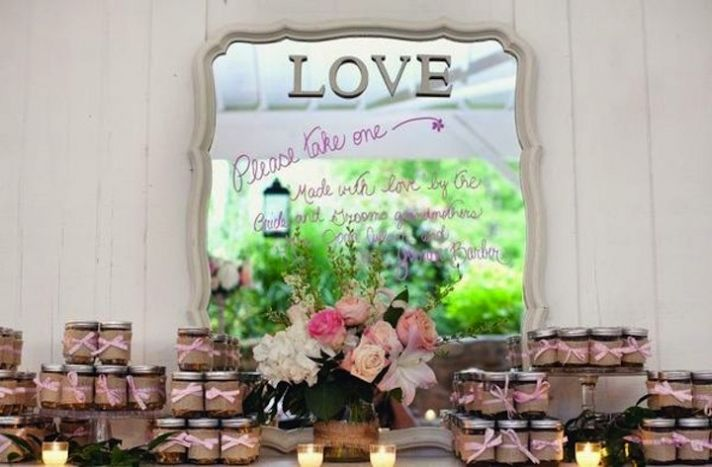 vintage romance wedding guest favors with mirror backdrop