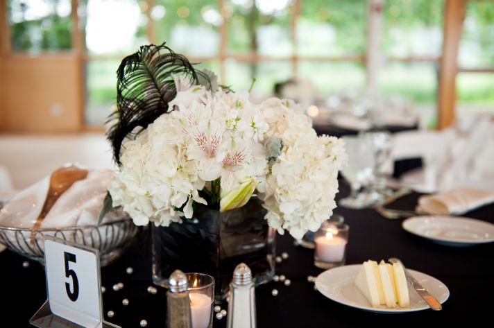 white wedding flowers we love hydrangea with black feathers