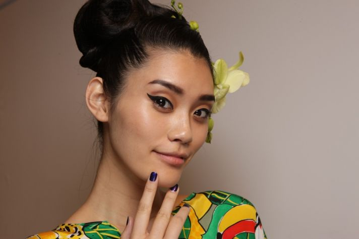 wedding hair makeup trends from fashion week cat eyes 1970s updo at Issa London