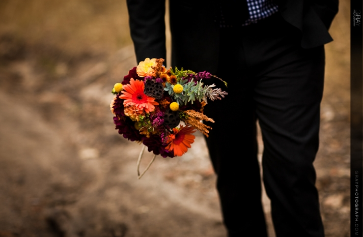 fall wedding flowers bouquets and centerpieces groom holds bouquet