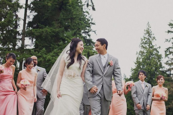 Bride and Groom Walk Hand in Hand After Outdoor Ceremony