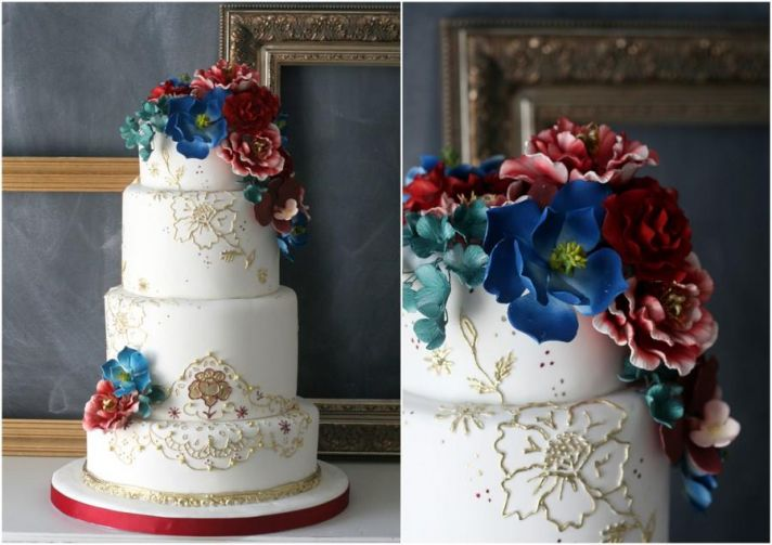Elegant White and Gold Wedding Cake with Jewel Tone Blooms