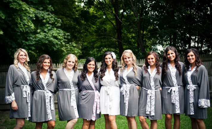 Bride poses with bridesmaids in eco friendly robes