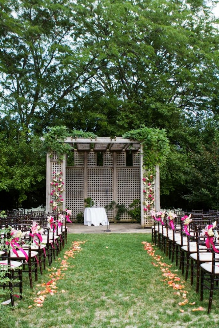 Outdoor Wedding Ceremony With Arbor And Flowers